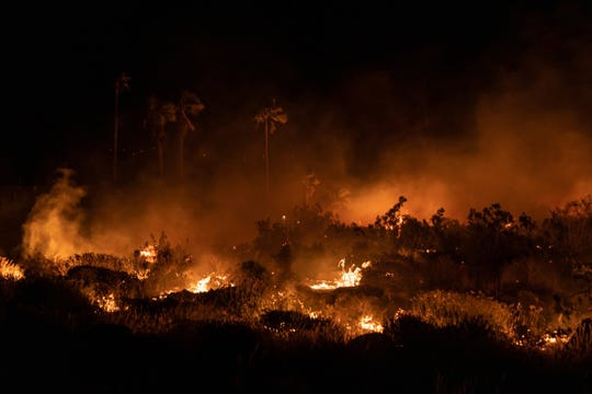 A field near Tramway Road and North Palm Canyon Drive burns Tuesday, April 9, 2019.