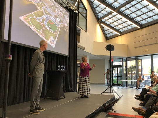 Urban planning expert Jeff Speck and Marina Khoury, a partner at the urban planning firm DPZ, give a presentation Tuesday on the West Main Master Plan at the Studer Community Institute.