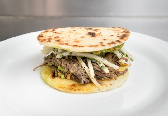 A pulled beef arepas at the Arepas food truck in Perdido on Wednesday, April 10, 2019.