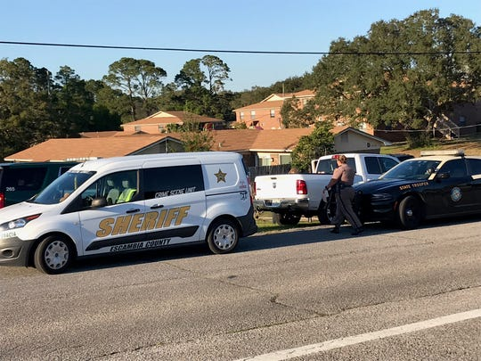 The Escambia County Sheriff's Office investigates Wednesday, April 10, 2019, after a 2-year-old was found dead in a car near a home on Meadson Road near Perdido Key.