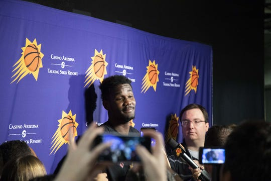 Deandre Ayton answer questions during the Suns' exit interviews on April 10.