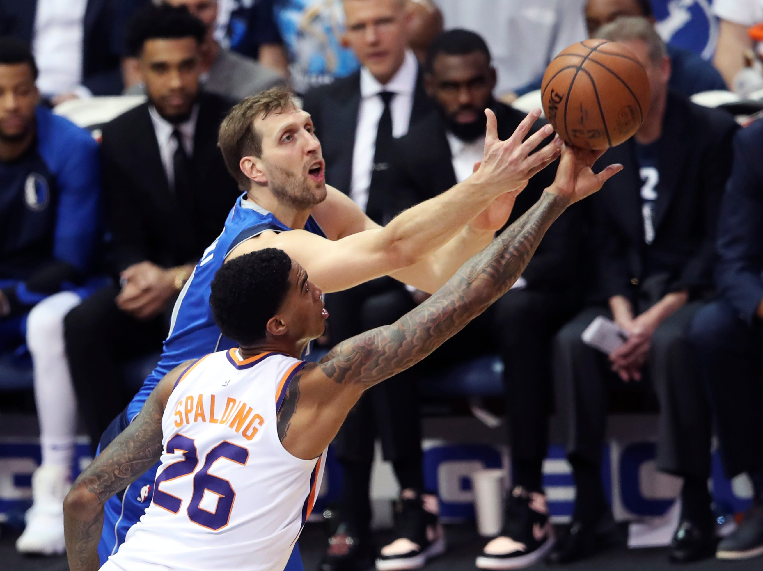 Apr 9, 2019; Dallas, TX, USA; Dallas Mavericks forward Dirk Nowitzki (41) and Phoenix Suns forward Ray Spalding (26) go for a loose ball during the first half at American Airlines Center. Mandatory Credit: Kevin Jairaj-USA TODAY Sports