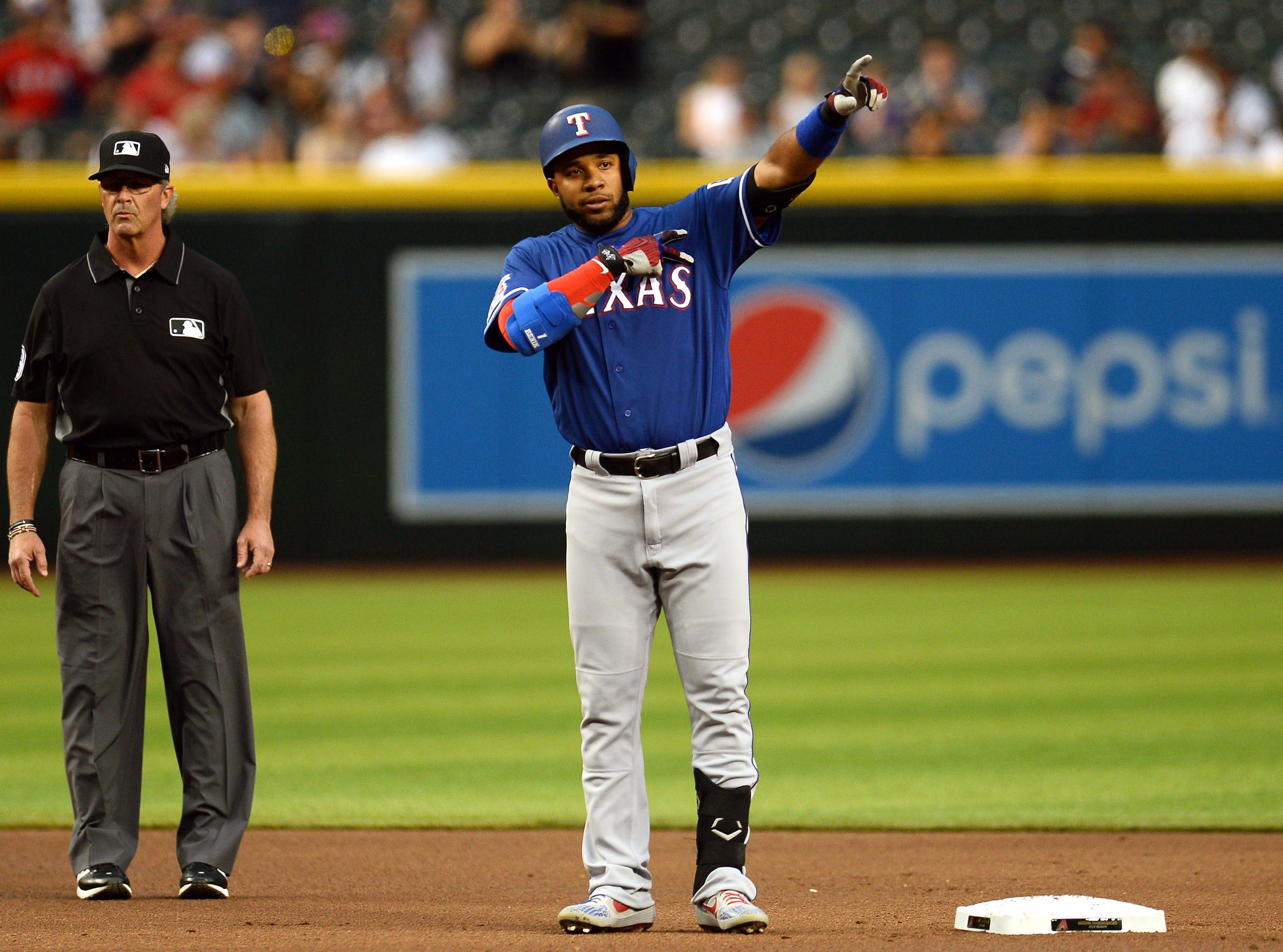 Apr 9, 2019; Phoenix, AZ, USA; Texas Rangers shortstop Elvis Andrus (1) reacts after hitting an RBI double against the Arizona Diamondbacks during the first inning at Chase Field. Mandatory Credit: Joe Camporeale-USA TODAY Sports