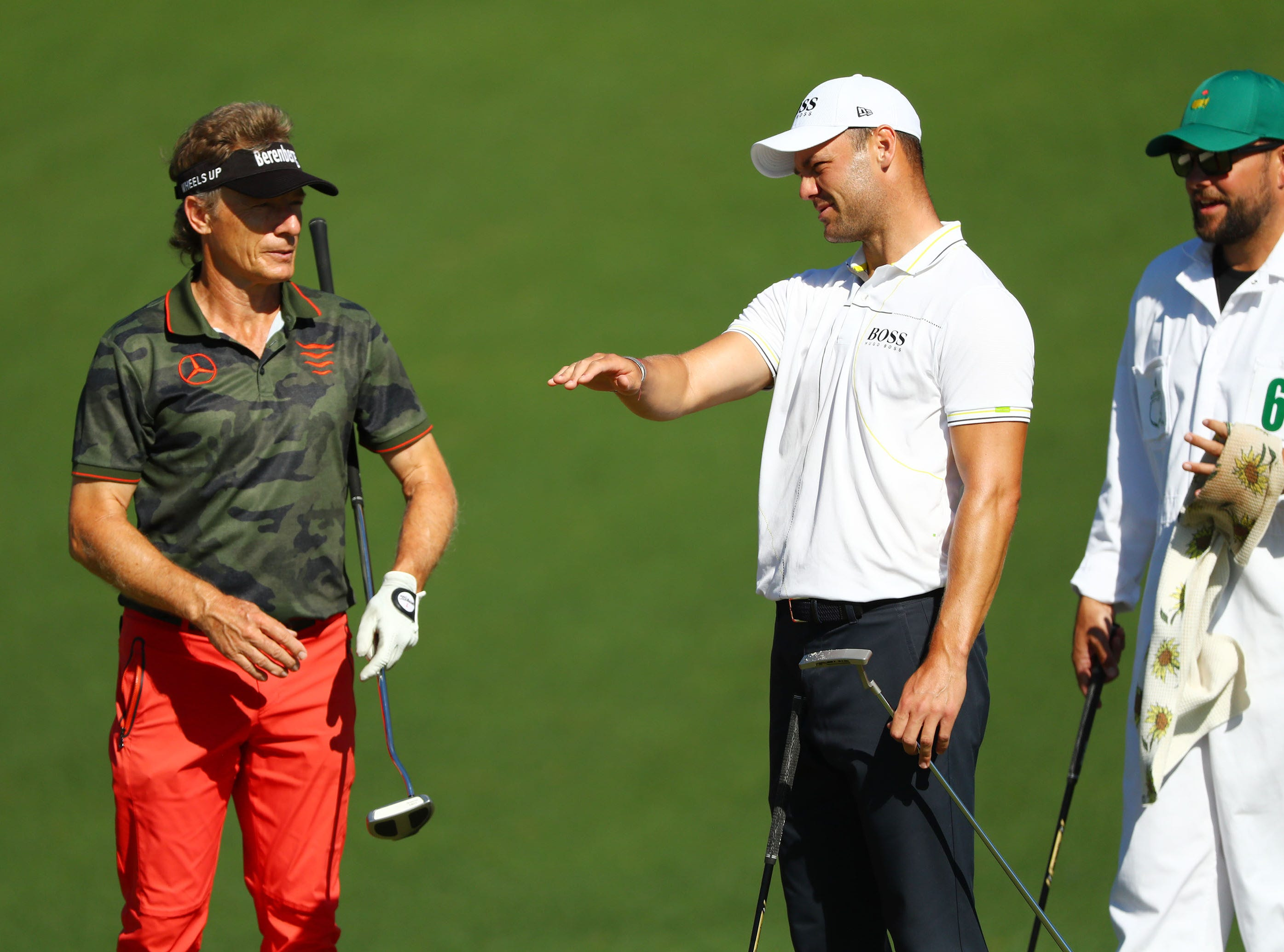 Apr 10, 2019; Augusta, GA, USA; Masters champion Bernhard Langer (left) and Martin Kaymer at the second green during a practice round for The Masters golf tournament at Augusta National Golf Club. Mandatory Credit: Rob Schumacher-USA TODAY Sports