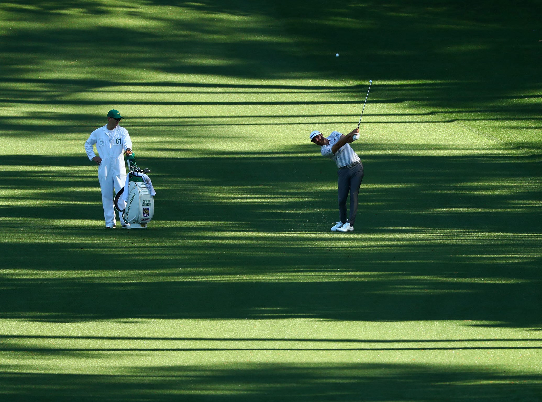 Apr 10, 2019; Augusta, GA, USA; Dustin Johnson plays a shot on the 10th fairway during a practice round for The Masters golf tournament at Augusta National Golf Club. Mandatory Credit: Rob Schumacher-USA TODAY Sports