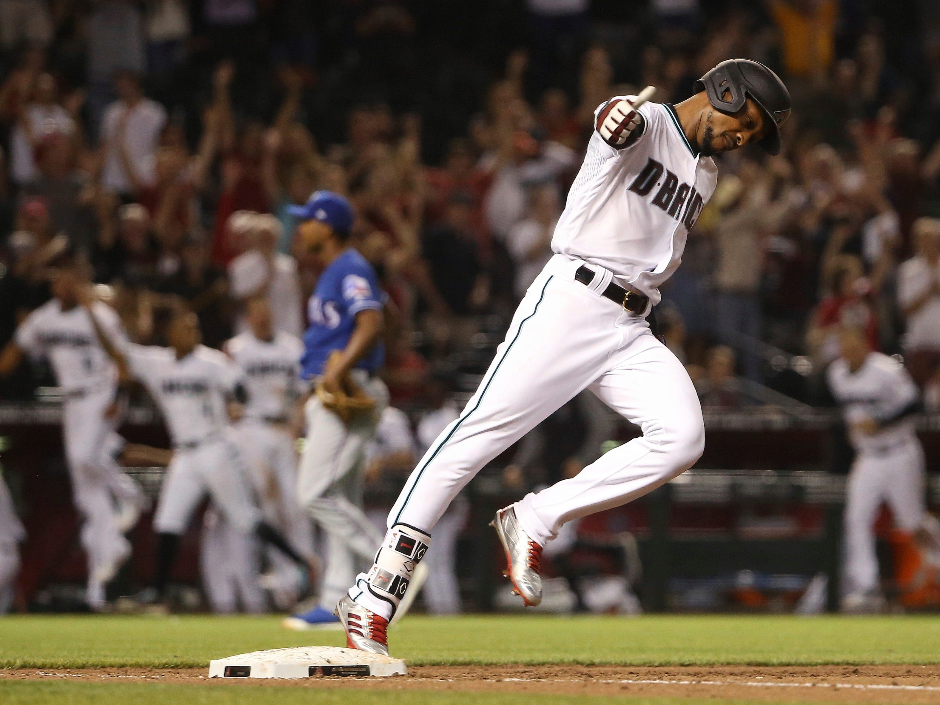 Arizona Diamondbacks' Jarrod Dyson celebrates his two-run walk-off home run against the Texas Rangers in a baseball game Tuesday, April 9, 2019, in Phoenix. The Diamondbacks defeated the Rangers 5-4. (AP Photo/Ross D. Franklin)