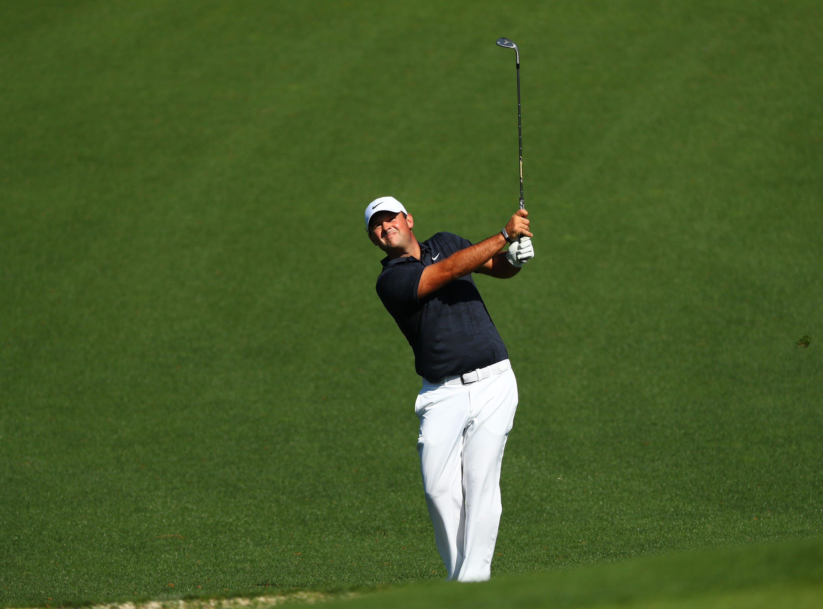 Apr 10, 2019; Augusta, GA, USA; Masters champion Patrick Reed plays a shot to the second green during a practice round for The Masters golf tournament at Augusta National Golf Club. Mandatory Credit: Rob Schumacher-USA TODAY Sports