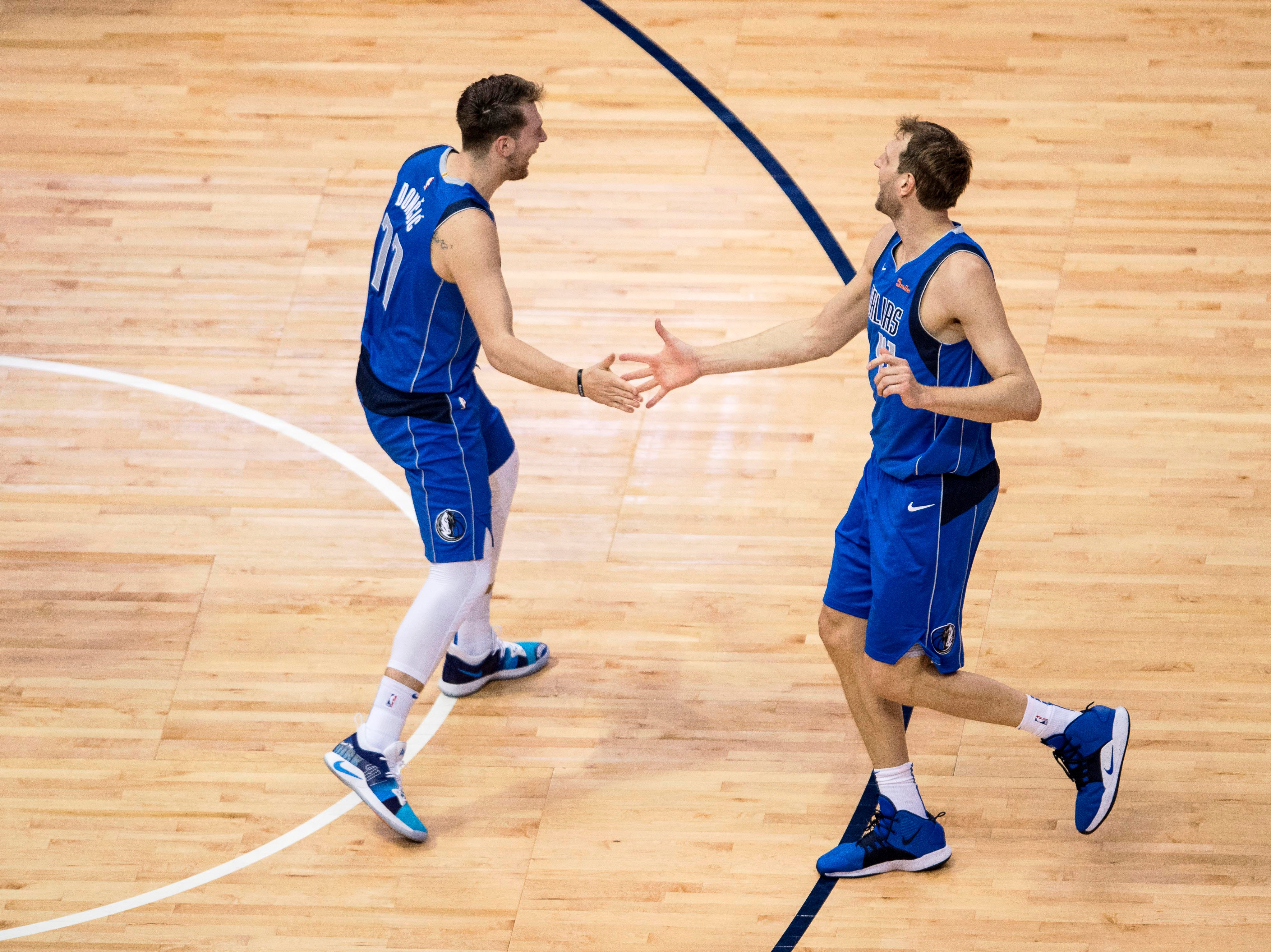 Apr 9, 2019; Dallas, TX, USA; Dallas Mavericks forward Luka Doncic (77) and forward Dirk Nowitzki (41) celebrate during the second half against the Phoenix Suns at the American Airlines Center. Mandatory Credit: Jerome Miron-USA TODAY Sports