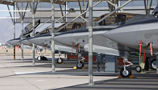 A line of F-35 Thunderbolt II fighters at Luke Air Force Base.