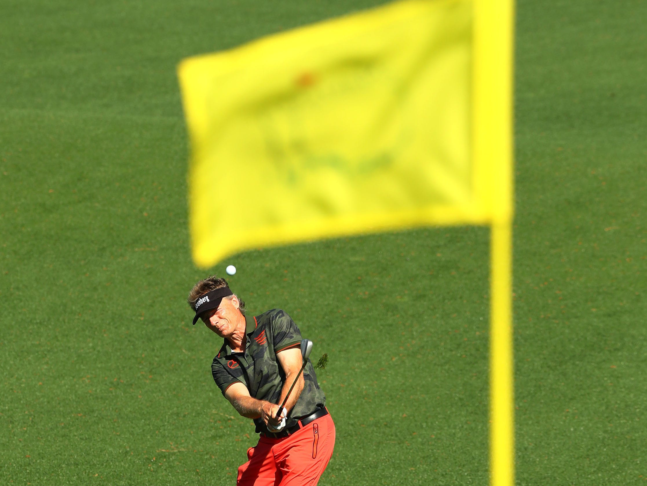 Apr 10, 2019; Augusta, GA, USA; Masters champion Bernhard Langer plays a shot to the second green during a practice round for The Masters golf tournament at Augusta National Golf Club. Mandatory Credit: Rob Schumacher-USA TODAY Sports