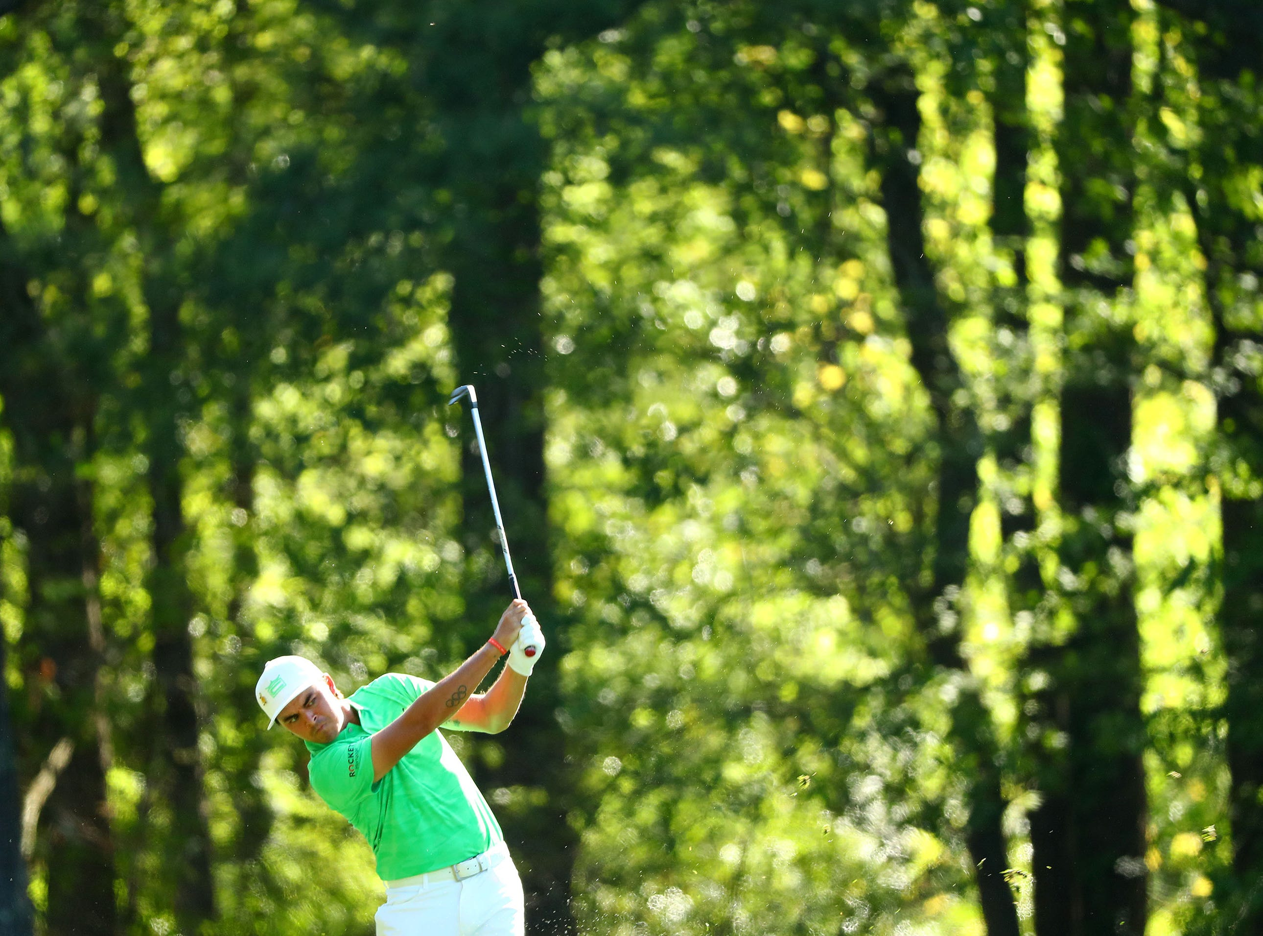 Apr 10, 2019; Augusta, GA, USA; Rickie Fowler plays a shot on the 11th hole during a practice round for The Masters golf tournament at Augusta National Golf Club. Mandatory Credit: Rob Schumacher-USA TODAY Sports