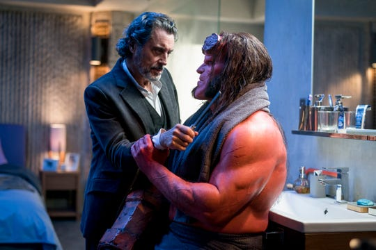 """Hellboy (David Harbour) confronts his father (Ian McShane) in """"Hellboy."""""""