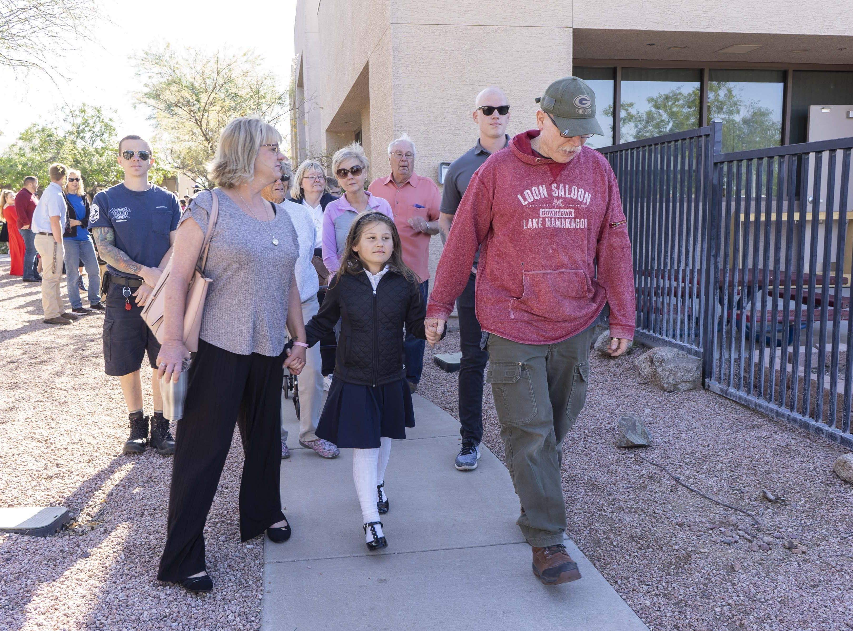 Tim Sullivan, on right, walks with his 6-year-old Abi Sullivan and Adelle Imm ( Tim's sister-in-law) was escorted by Mesa fire crews to Faith Christian School on Wednesday, April 10th, riding in a fire engine #216. Abi is the daughter of Nikki Sullivan, who medically retired in 2015 due to occupational cancer and died last Wednesday. The fire crew will drive Abi,  Tim (Nikki's husband and retired fire captain) to the school.