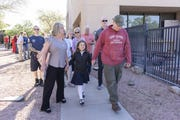 Tim Sullivan, on right, walks with his 6-year-old Abi Sullivan and Adelle Imm ( Tim's sister-in-law) was escorted by Mesa fire crews to Faith Christian School on Wednesday, April 10th, riding in a fire engine #216.