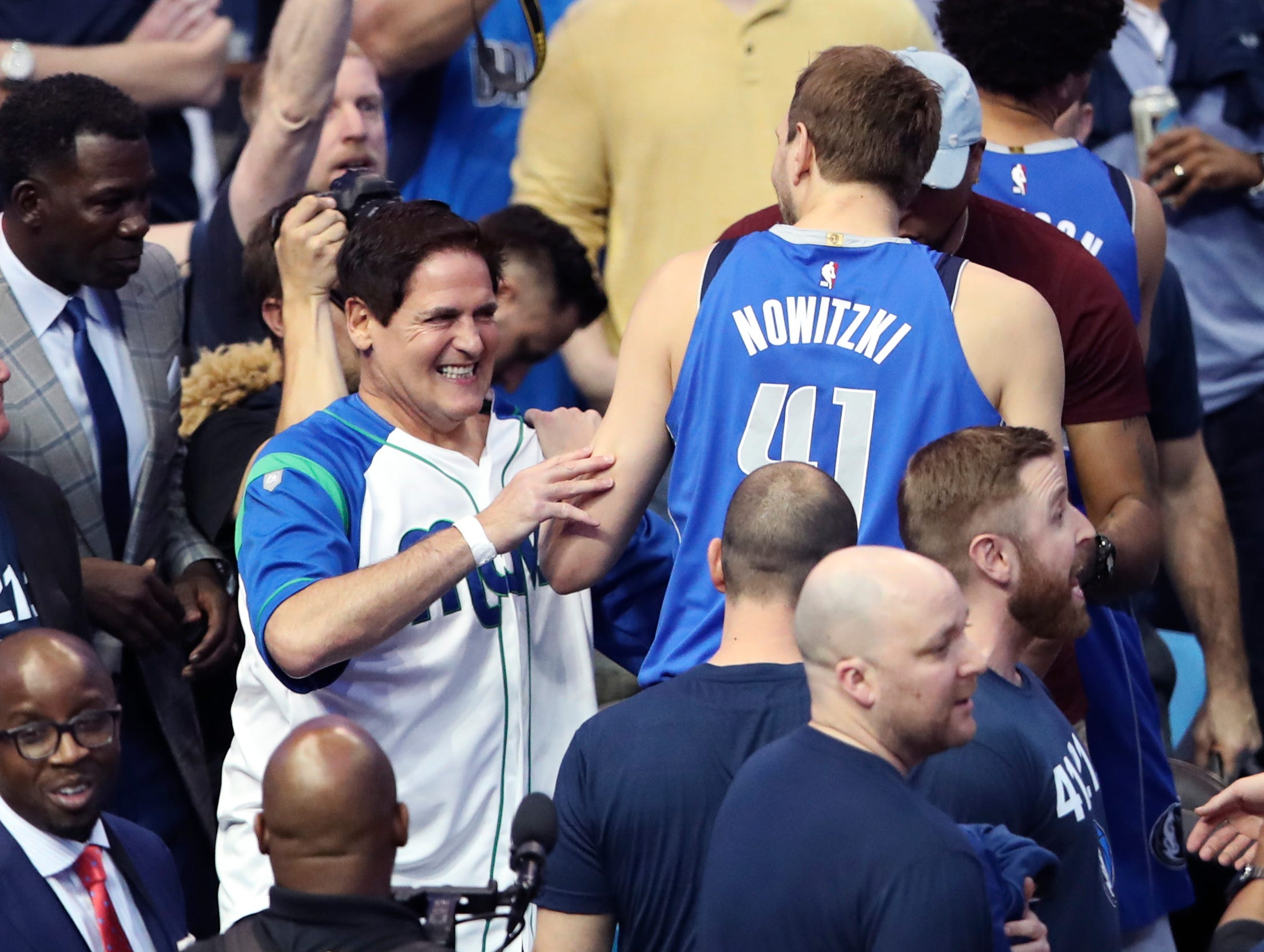 Apr 9, 2019; Dallas, TX, USA; Dallas Mavericks owner Mark Cuban laughs with forward Dirk Nowitzki (41) before the game against the Phoenix Suns at American Airlines Center. Mandatory Credit: Kevin Jairaj-USA TODAY Sports