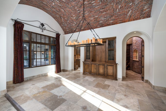 The Paradise Valley estate, sold by Robert and Janet Bohannon, features a formal dining room with a brick barrel vaulted ceiling.