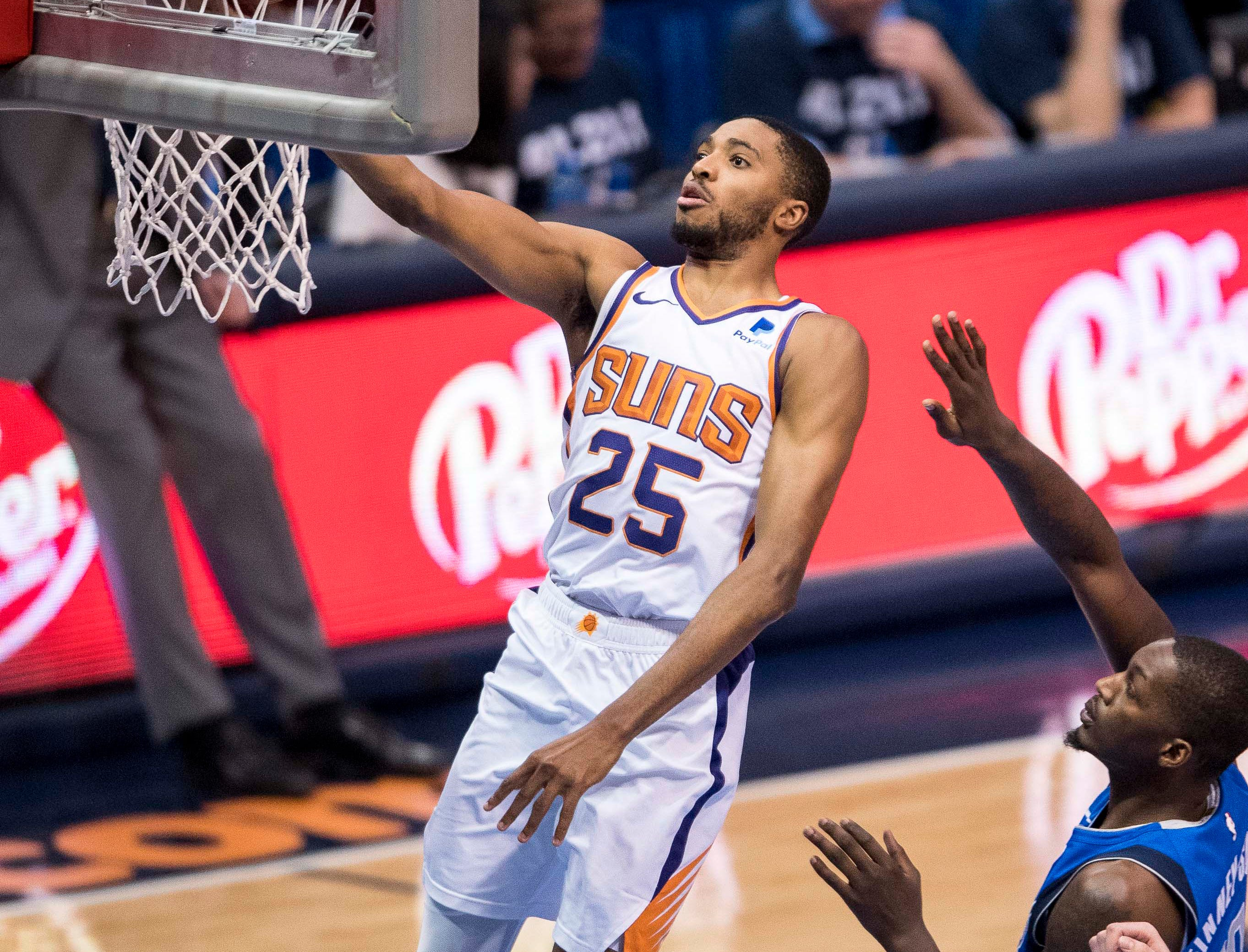 Apr 9, 2019; Dallas, TX, USA; Phoenix Suns forward Mikal Bridges (25) drives to the basket against Dallas Mavericks forward Dorian Finney-Smith (10) during the second half at the American Airlines Center. Mandatory Credit: Jerome Miron-USA TODAY Sports