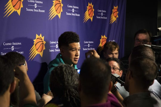 Devin Booker averaged a career-high 26.6 points with 6.8 assists per game during the 2018-19 season.
