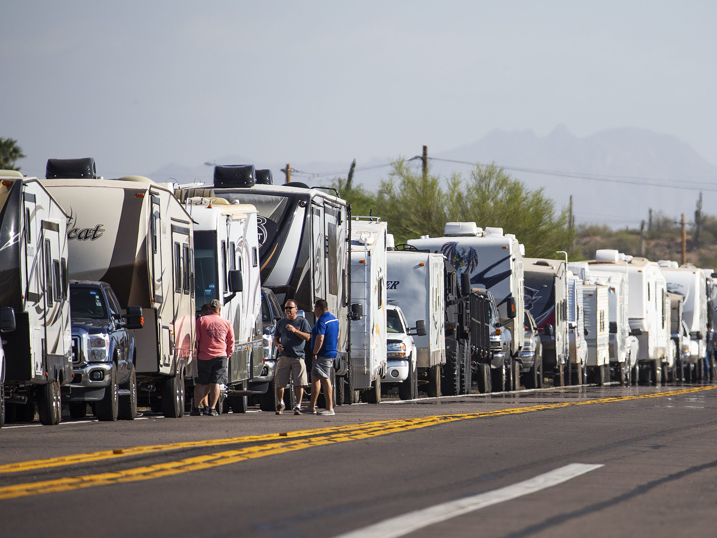 Hundreds of vehicles, including campers and trailers, wait in line to enter the Country Thunder Arizona country music festival on April 10, 2019.