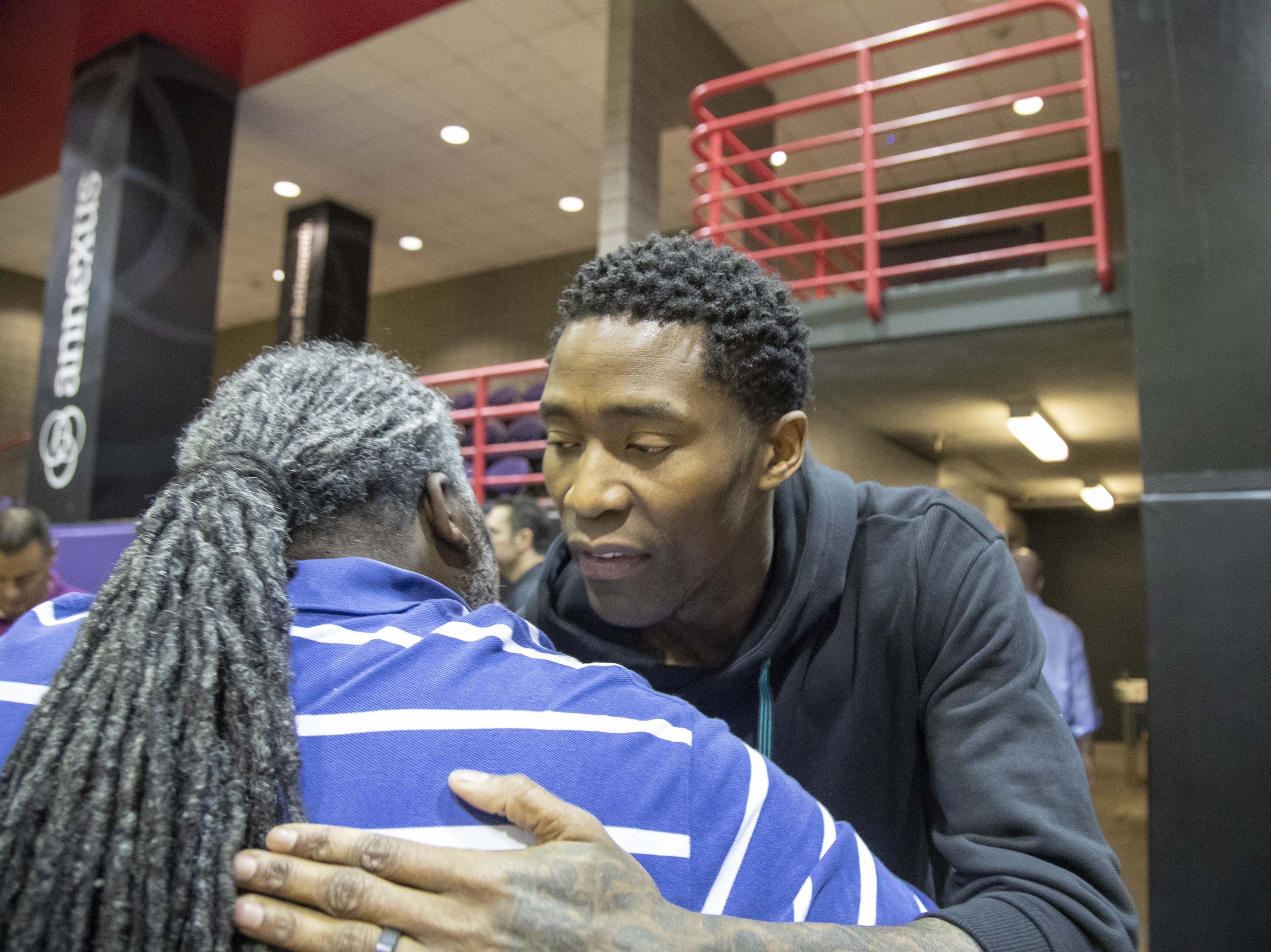 Jamal Crawford gives someone a hug during the Suns' exit interviews on April 10 at Talking Stick Resort Arena.