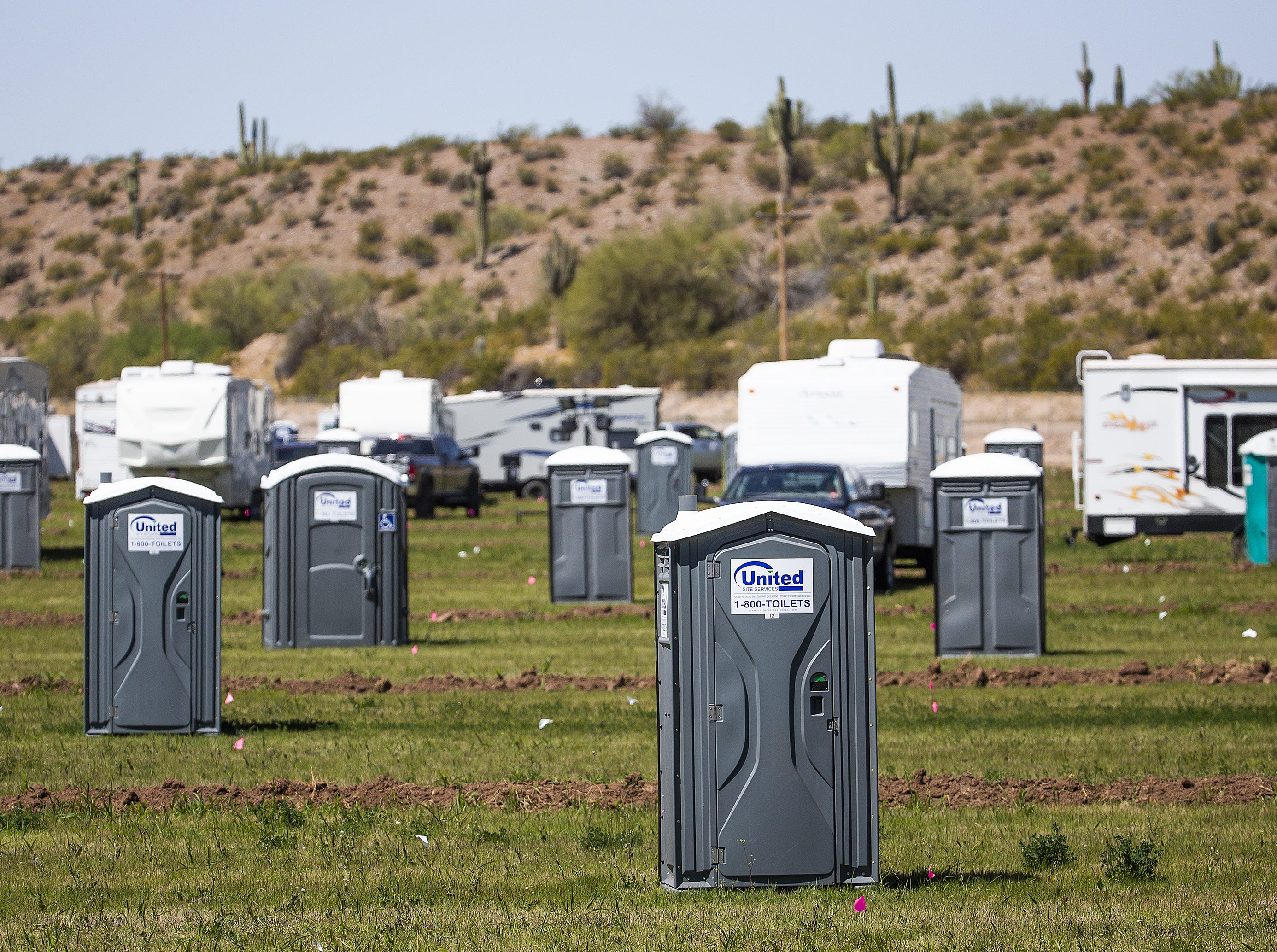 Hundreds of portable toilets are scattered throughout the campsites at the Country Thunder Arizona 2019 music festival outside Florence, April 10, 2019.
