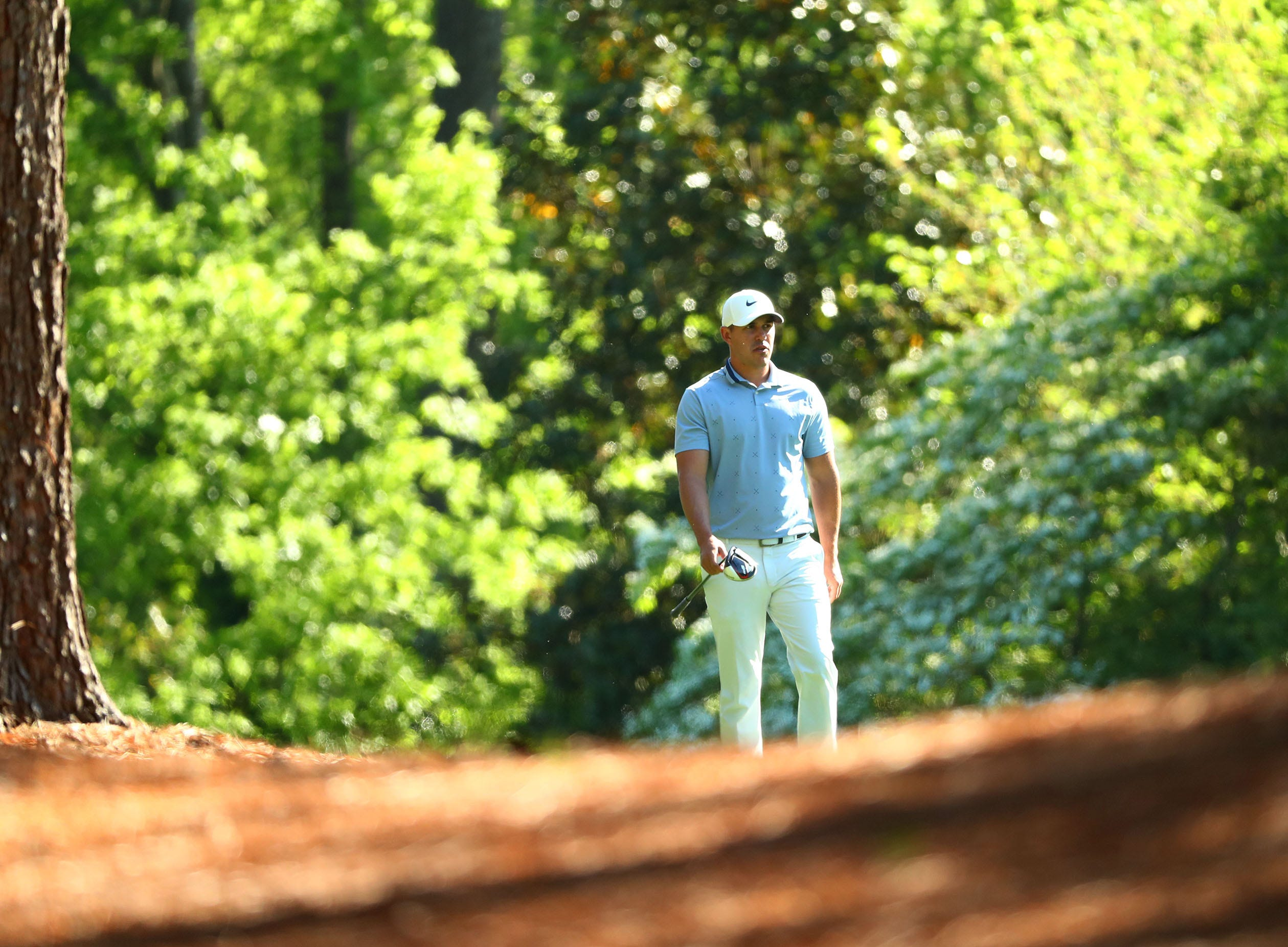 Apr 10, 2019; Augusta, GA, USA; Brooks Koepka walks to his ball on the 11th hole during a practice round for The Masters golf tournament at Augusta National Golf Club. Mandatory Credit: Rob Schumacher-USA TODAY Sports
