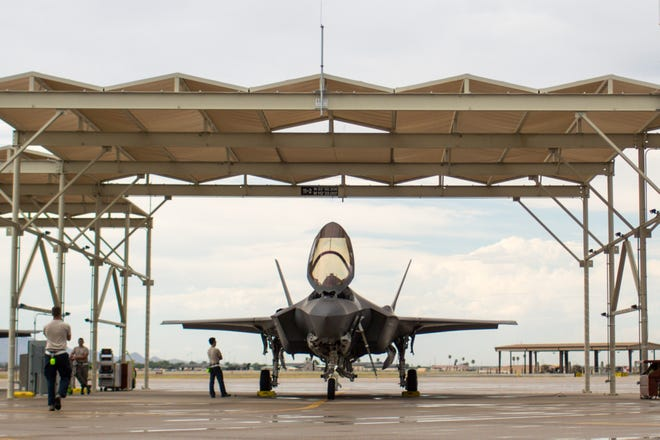 Ground crews check an F-35 before the pilot arrives to fly it at Luke Air Force Base.