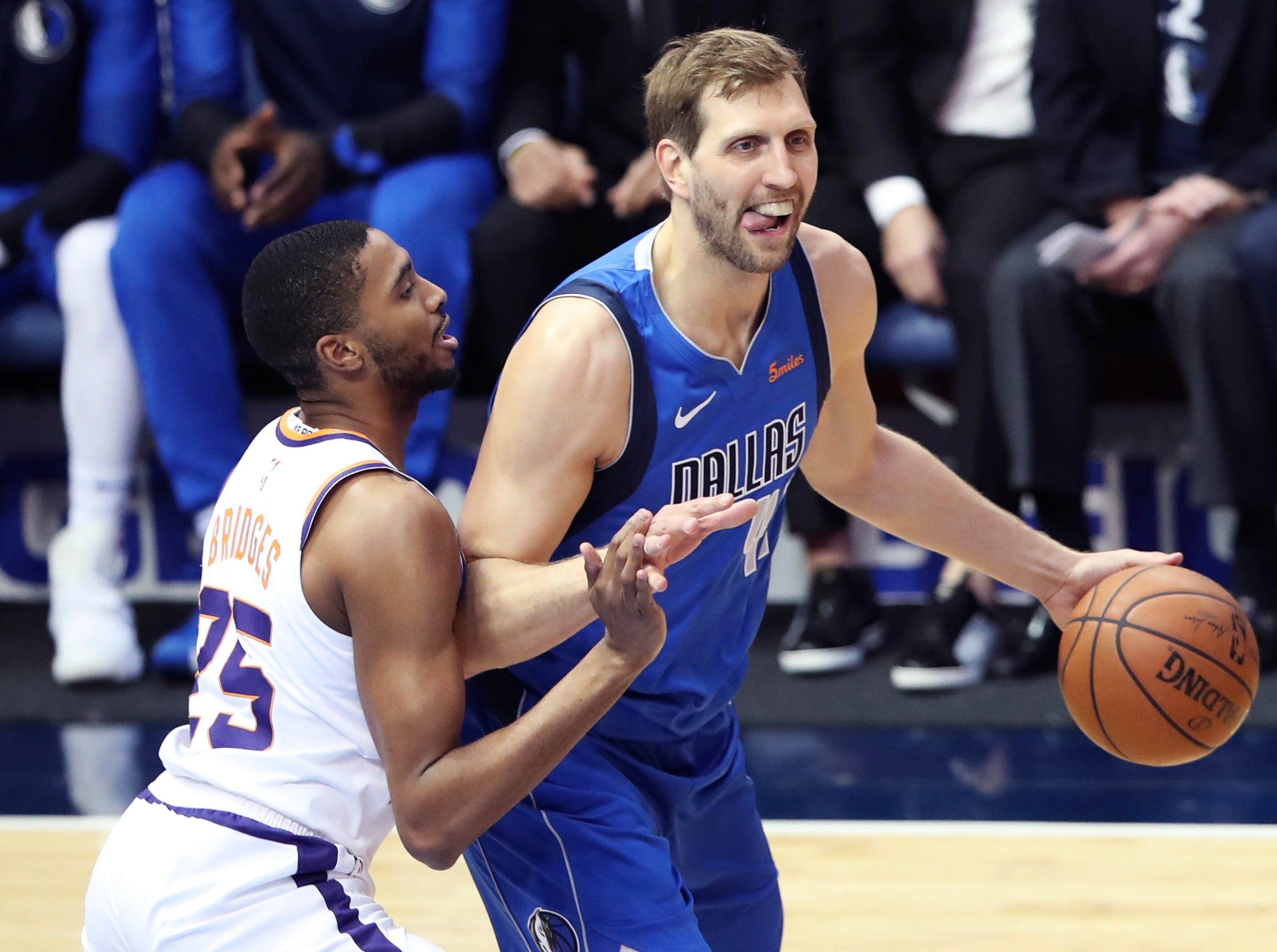 Apr 9, 2019; Dallas, TX, USA; Dallas Mavericks forward Dirk Nowitzki (41) looks to shoot as Phoenix Suns forward Mikal Bridges (25) defends during the first half at American Airlines Center. Mandatory Credit: Kevin Jairaj-USA TODAY Sports