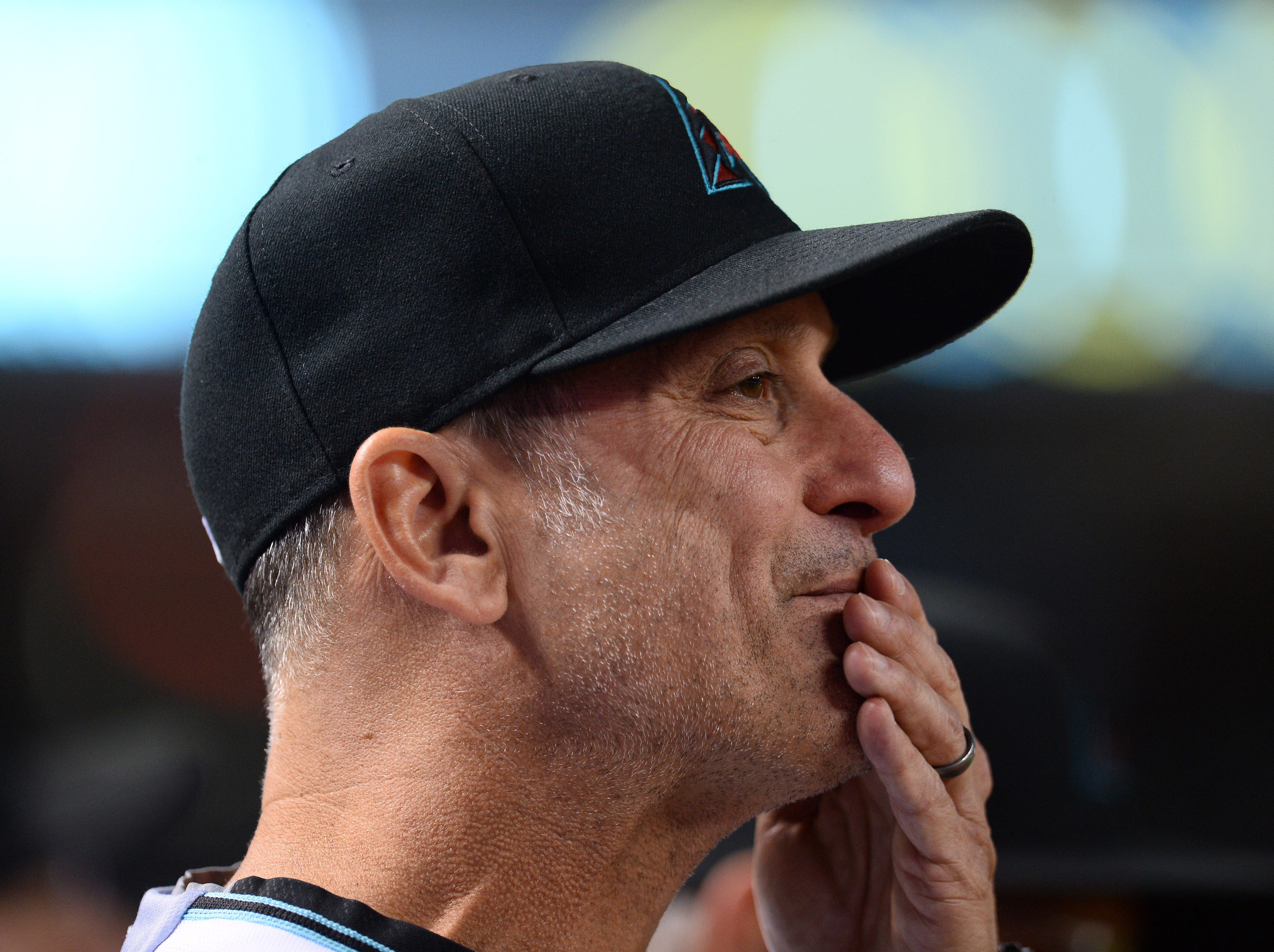Apr 9, 2019; Phoenix, AZ, USA; Arizona Diamondbacks manager Torey Lovullo (17) looks on during the eighth inning against the Texas Rangers at Chase Field. Mandatory Credit: Joe Camporeale-USA TODAY Sports