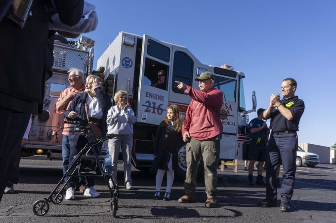 Tim Sullivan, in center, and his 6-year-old Abi Sullivan was escorted by Mesa fire crews to Faith Christian School on Wednesday, April 10th, riding in a fire engine #216. Abi is the daughter of Nikki Sullivan, who medically retired in 2015 due to occupational cancer and died last Wednesday. The fire crew will drive Abi,  Tim (Nikki's husband and retired fire captain) to the school.