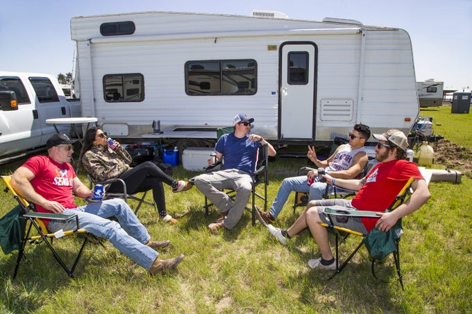 Friends from Tucson enjoy a cold beer after setting up their camping site at the Country Thunder Arizona 2019 music festival outside Florence, April 10, 2019. From left to right are;  John Mellum, 27, Alexis Balderrama, 21, Jeffrey Weiler, 27, Richard Como, 27, and Brandon Holley, 27.