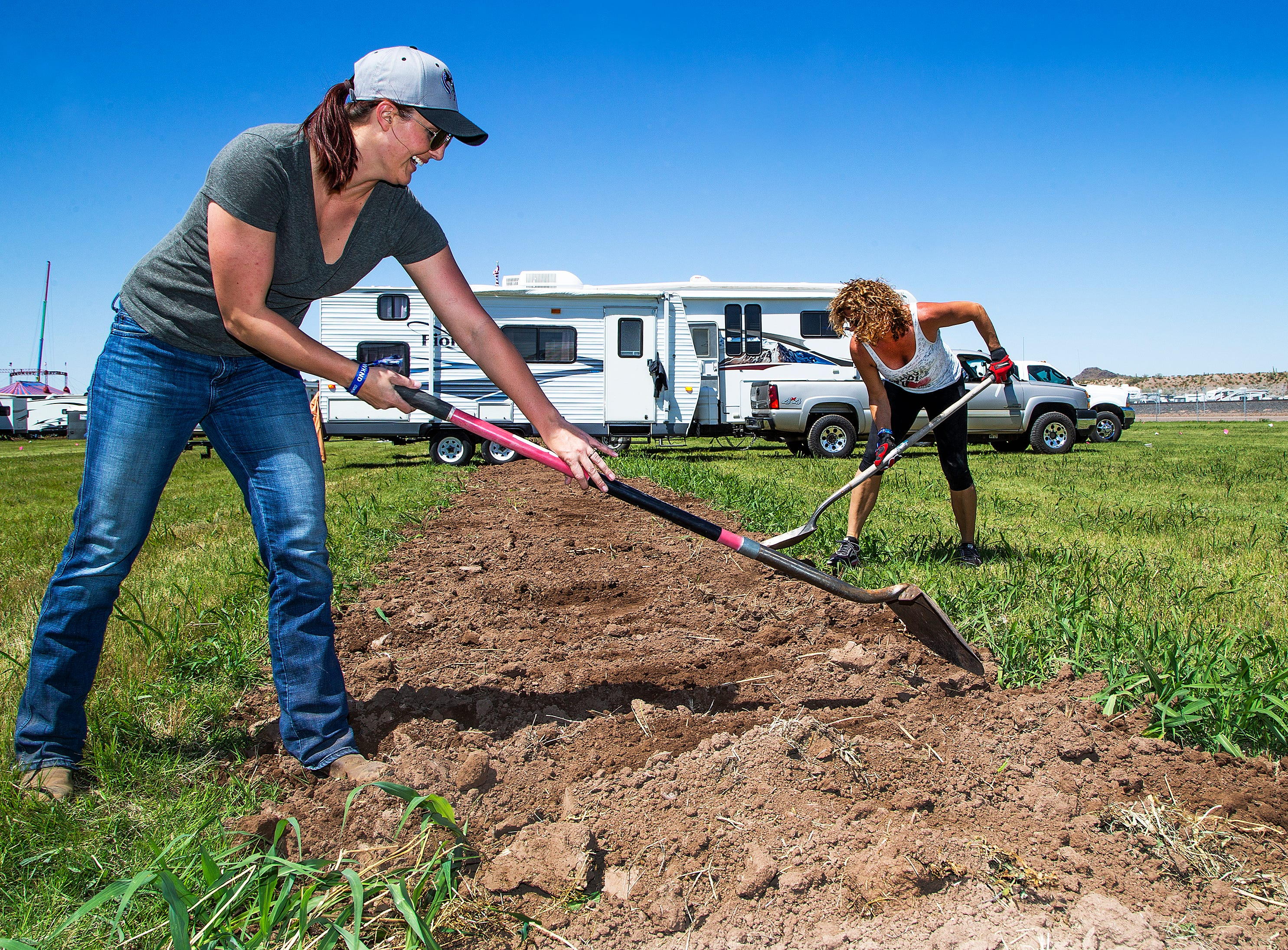 Mackenzie Core (left), 29, of Flagstaff, and Denise O'Brien, 47, of Queen Creek, prepare their camping site at the Country Thunder Arizona 2019 music festival outside Florence April 10, 2019. The two ladies have 49 friends coming to camp. O'Brien has been coming to the festival for 14 years.