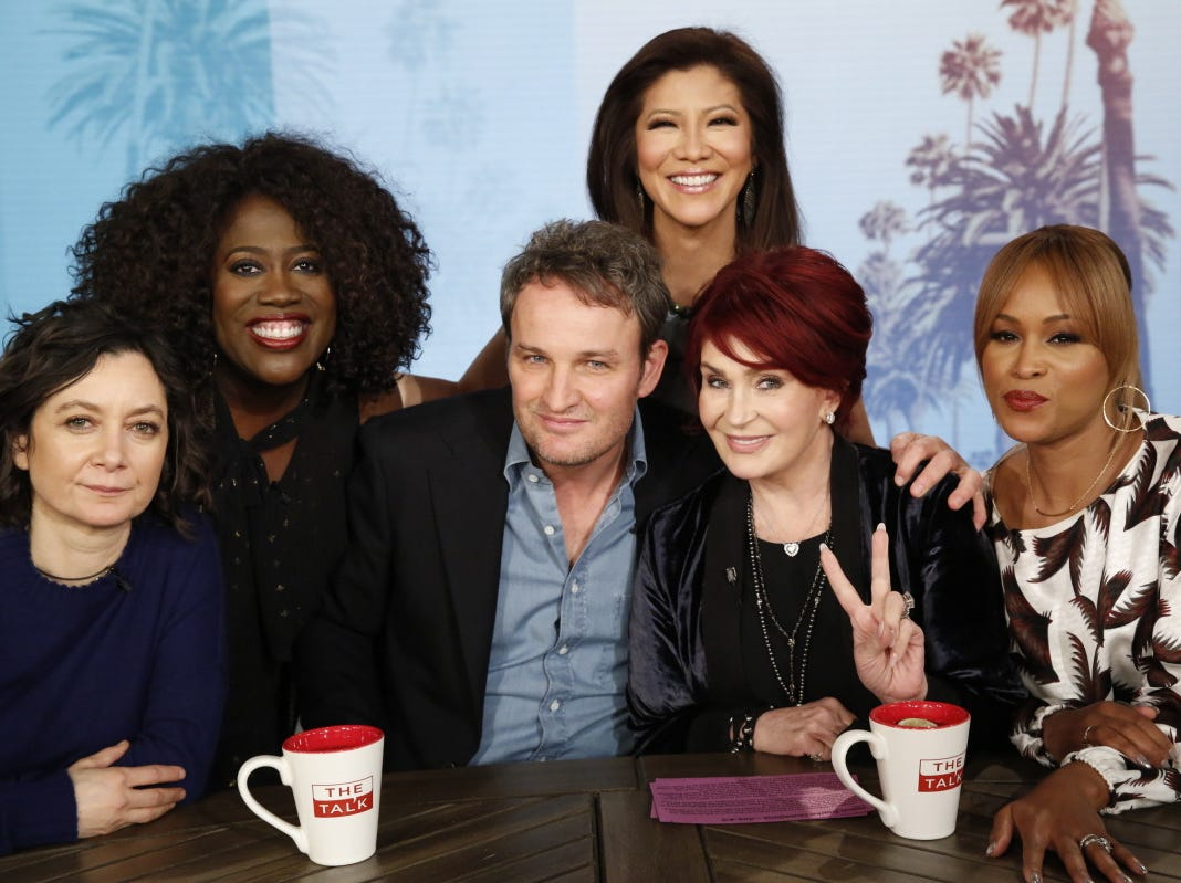 "Jason Clarke stops by ""The Talk"" on April 5, 2019. Sara Gilbert (from left), Sheryl Underwood, Julie Chen, Sharon Osbourne and Eve flank the actor."