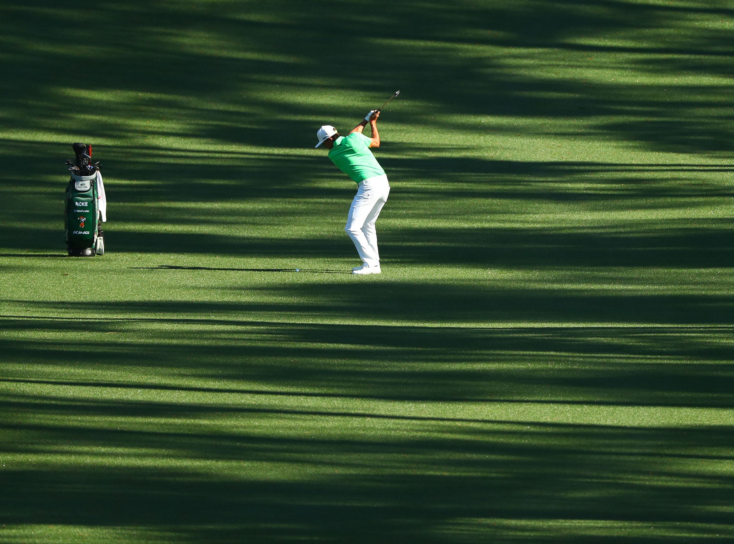 Apr 10, 2019; Augusta, GA, USA; Rickie Fowler plays a shot on the 10th fairway during a practice round for The Masters golf tournament at Augusta National Golf Club. Mandatory Credit: Rob Schumacher-USA TODAY Sports