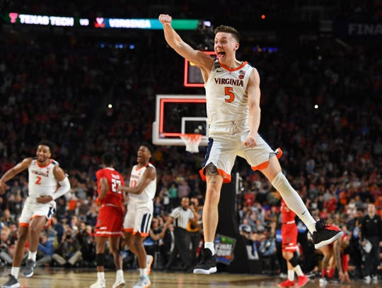 Virginia Cavaliers guard Kyle Guy (celebrate winning the game over the Texas Tech Red Raiders in overtime in the championship game of the 2019 men's Final Four