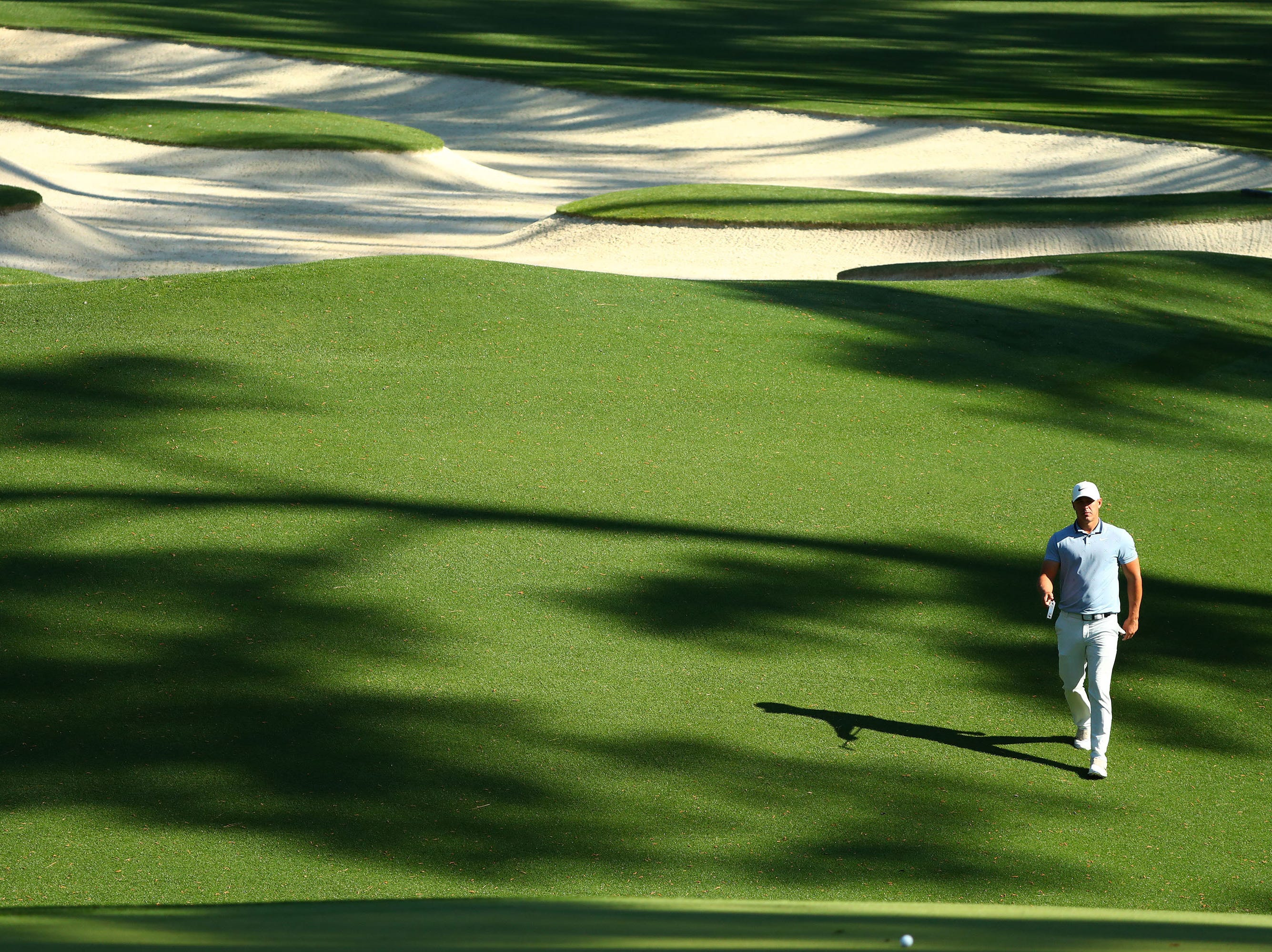 Apr 10, 2019; Augusta, GA, USA; Brooks Koepka walks to the 10th green during a practice round for The Masters golf tournament at Augusta National Golf Club. Mandatory Credit: Rob Schumacher-USA TODAY Sports