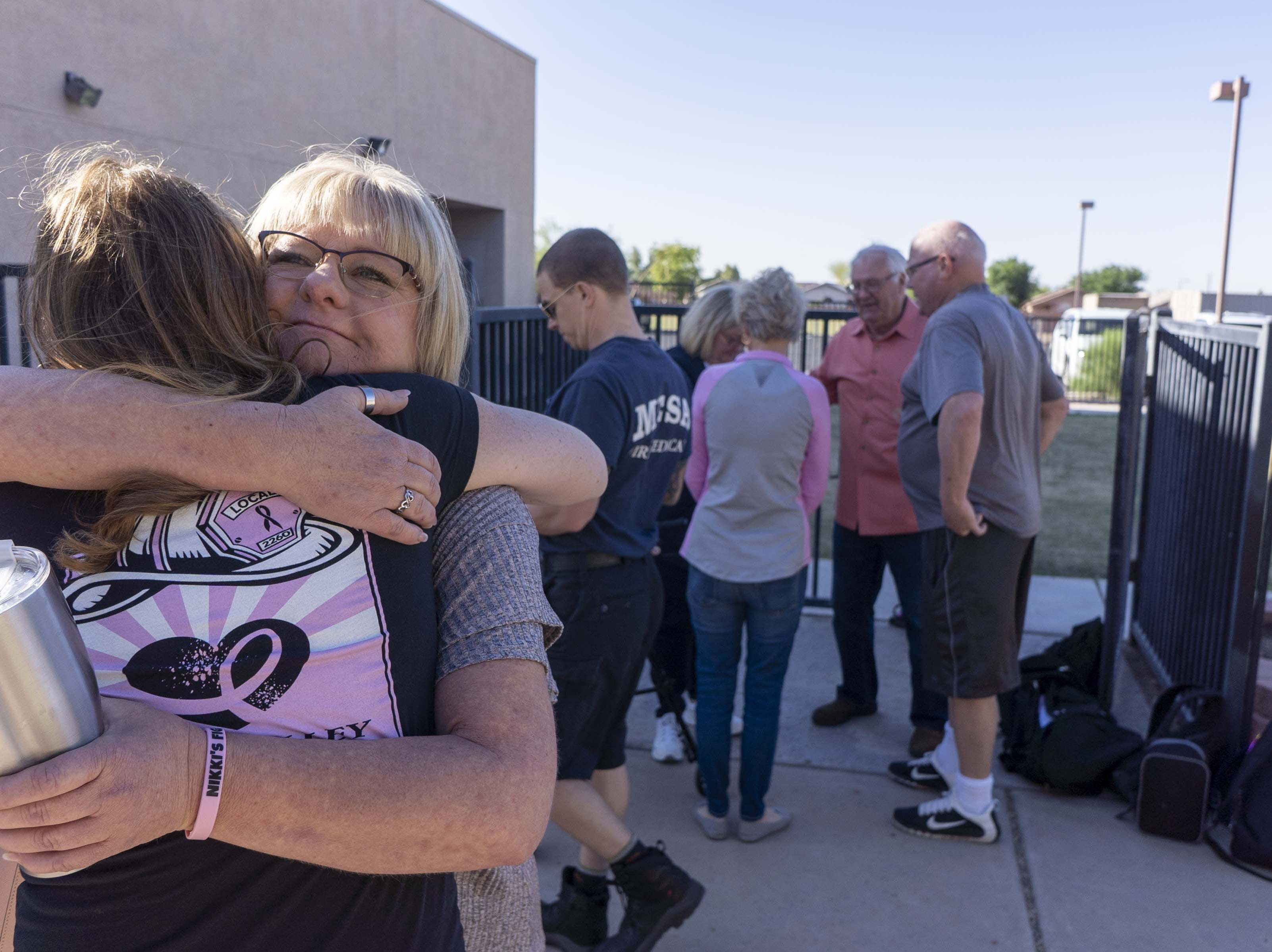 Adelle Imm gets a hug from family members at Faith Christian School on Wednesday, April 10th. Imm is a sister of Nikki Sullivan, who medically retired in 2015 due to occupational cancer and died last Wednesday. The fire crew will drive Abi,  Tim (Nikki's husband and retired fire captain) to the school.      Mesa fire crews bring 6-year-old Abi Sullivan to Faith Christian School on Wednesday, April 10th, riding in a fire engine #216. Abi is the daughter of Nikki Sullivan, who medically retired in 2015 due to occupational cancer and died last Wednesday. The fire crew will drive Abi,  Tim (Nikki's husband and retired fire captain) to the school.