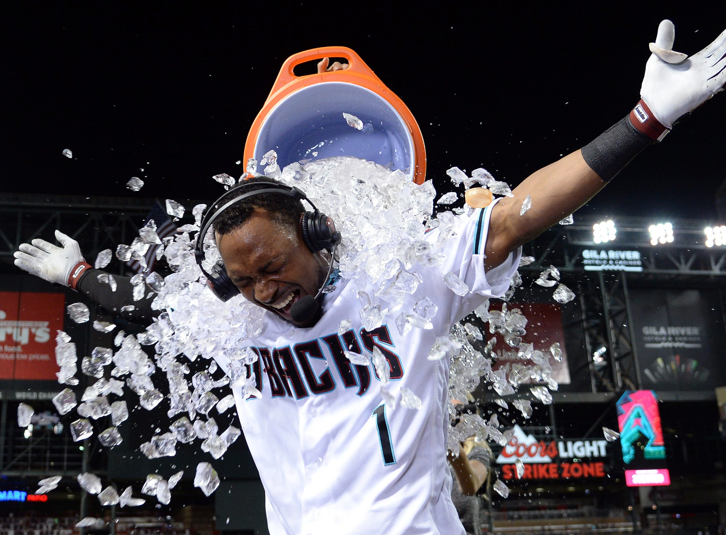 Apr 9, 2019; Phoenix, AZ, USA; Arizona Diamondbacks center fielder Jarrod Dyson (1) reacts as he is doused with Gatorade after ninth inning walk off two run home run against the Texas Rangers at Chase Field. Mandatory Credit: Joe Camporeale-USA TODAY Sports
