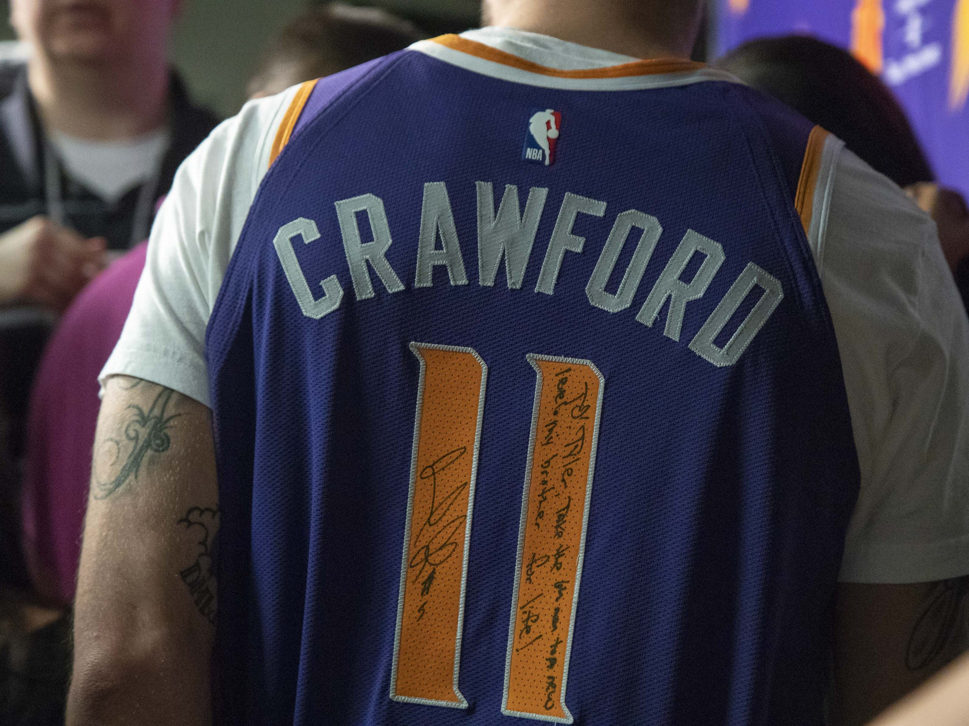 Tyler Johnson wears a signed Jamal Crawford jersey during the Suns' exit interviews on April 10.