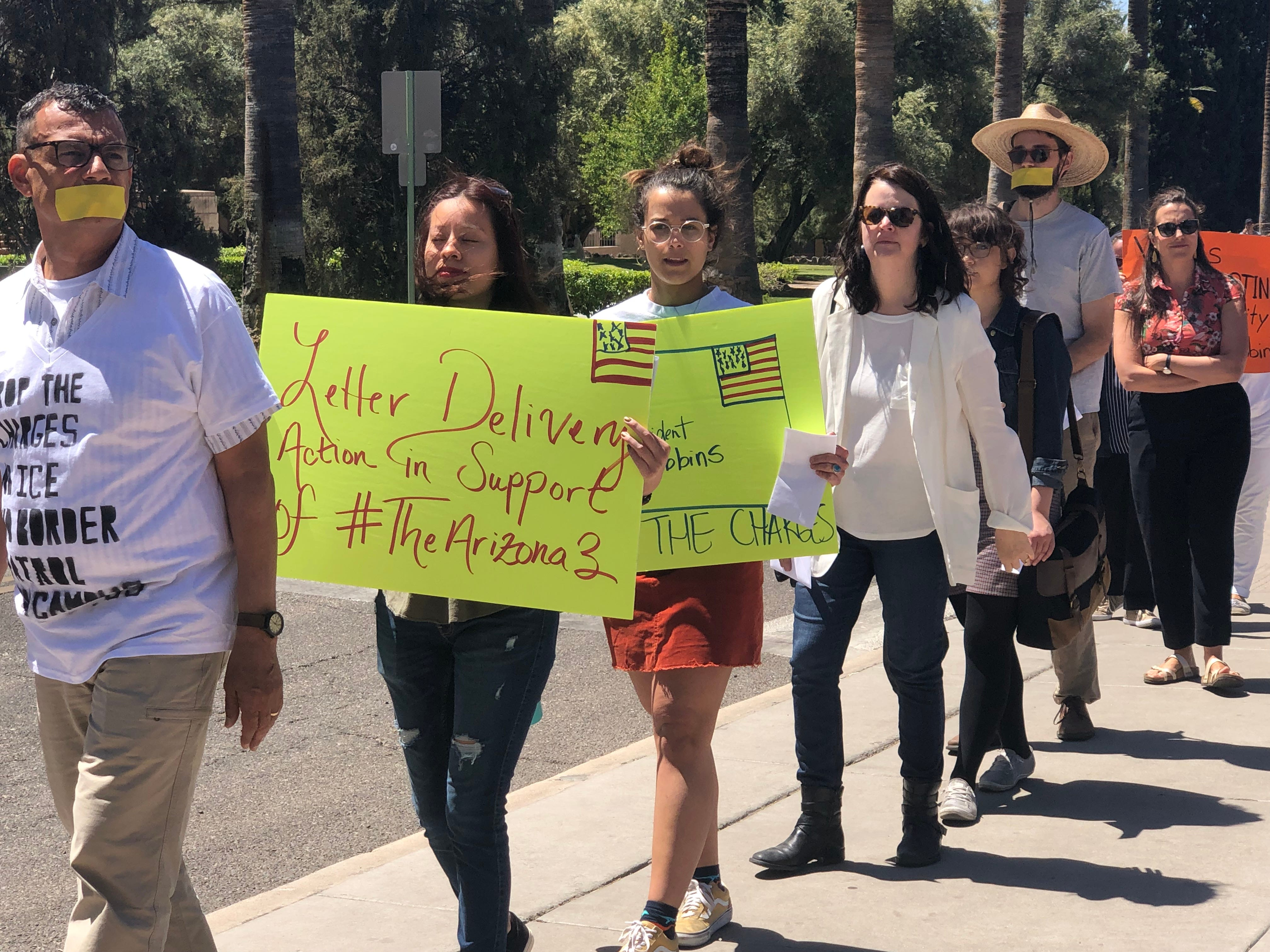 University of Arizona students and faculty protest the charges against three students, who protested a Border Patrol visit, on April 10, 2019.