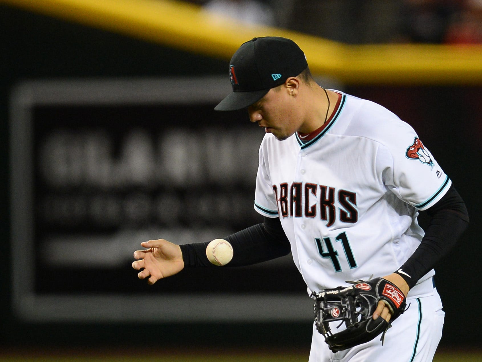 Apr 9, 2019; Phoenix, AZ, USA; Arizona Diamondbacks third baseman Wilmer Flores (41) reacts after misplaying a ground ball against the Texas Rangers during the second inning at Chase Field. Mandatory Credit: Joe Camporeale-USA TODAY Sports