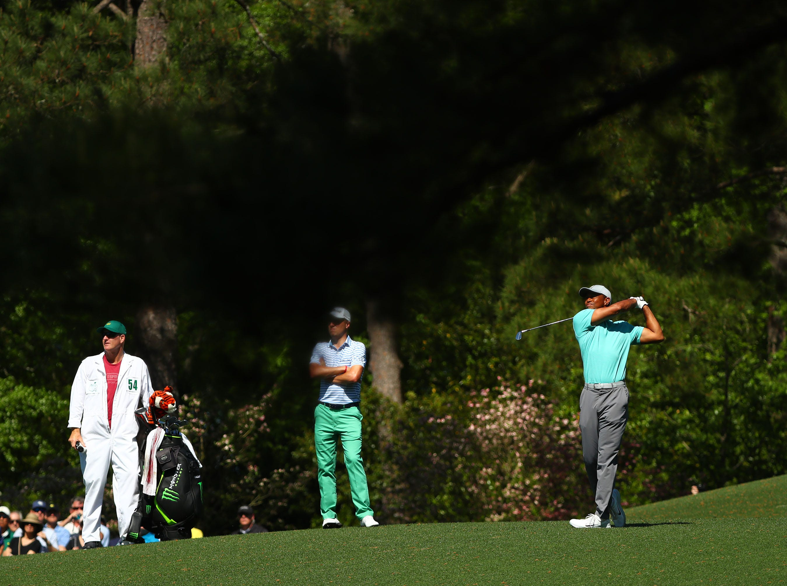 Apr 10, 2019; Augusta, GA, USA; Masters champion Tiger Woods plays a shot on the second hole during a practice round for The Masters golf tournament at Augusta National Golf Club. Mandatory Credit: Rob Schumacher-USA TODAY Sports
