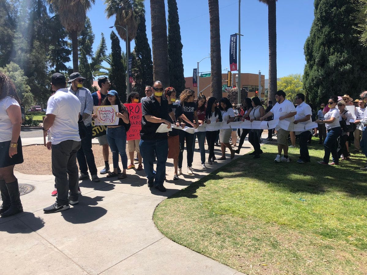 Students, faculty and community members deliver letters to UA President Robert Robbins opposing charges against student protesters during an event on April 10, 2019.