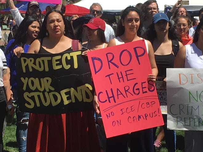 Students and activists protest against the University of Arizona administration and the Border Patrol on April 10, 2019 on the UA campus, after three students were cited for harassing Border Patrol agents on campus a few weeks ago.