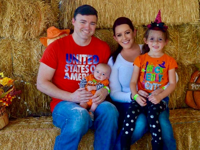Michael and Mandy Bissey pose for a photo with their children, Atticus and Isabella. The Bisseys married at Country Thunder in 2018.