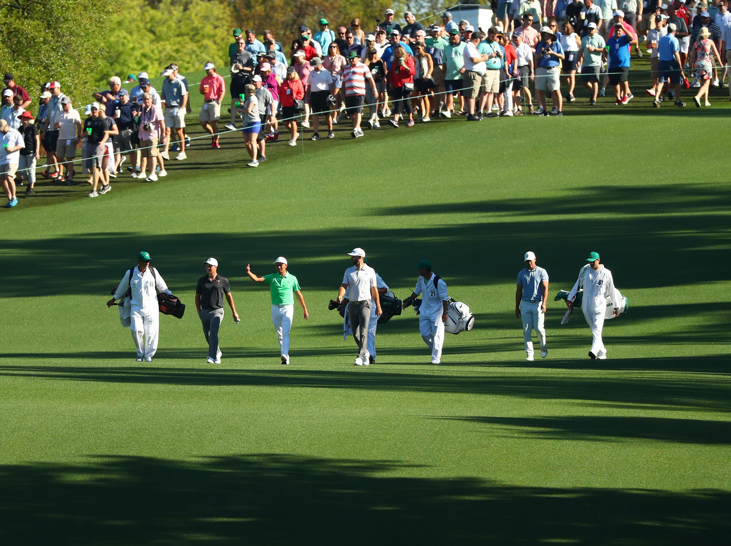 Apr 10, 2019; Augusta, GA, USA; Amateur Viktor Hovland (left), Rickie Fowler, Dustin Johnson and Brooks Koepka (right) walk down the 10th fairway during a practice round for The Masters golf tournament at Augusta National Golf Club. Mandatory Credit: Rob Schumacher-USA TODAY Sports