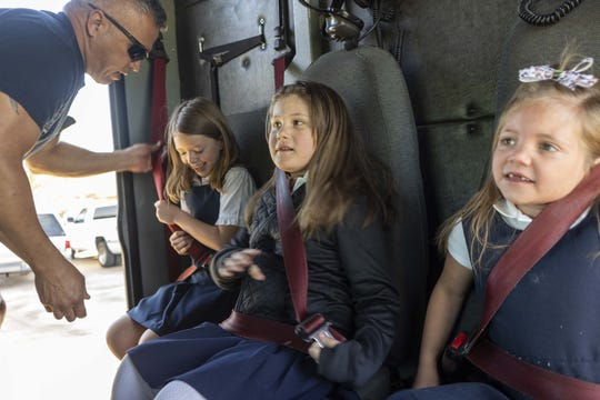 Mesa fire crew Guillermo Montano, help 6-year-old Abi Sullivan, in center and her school friends to Faith Christian School on Wednesday, April 10th, riding in a fire engine #216.