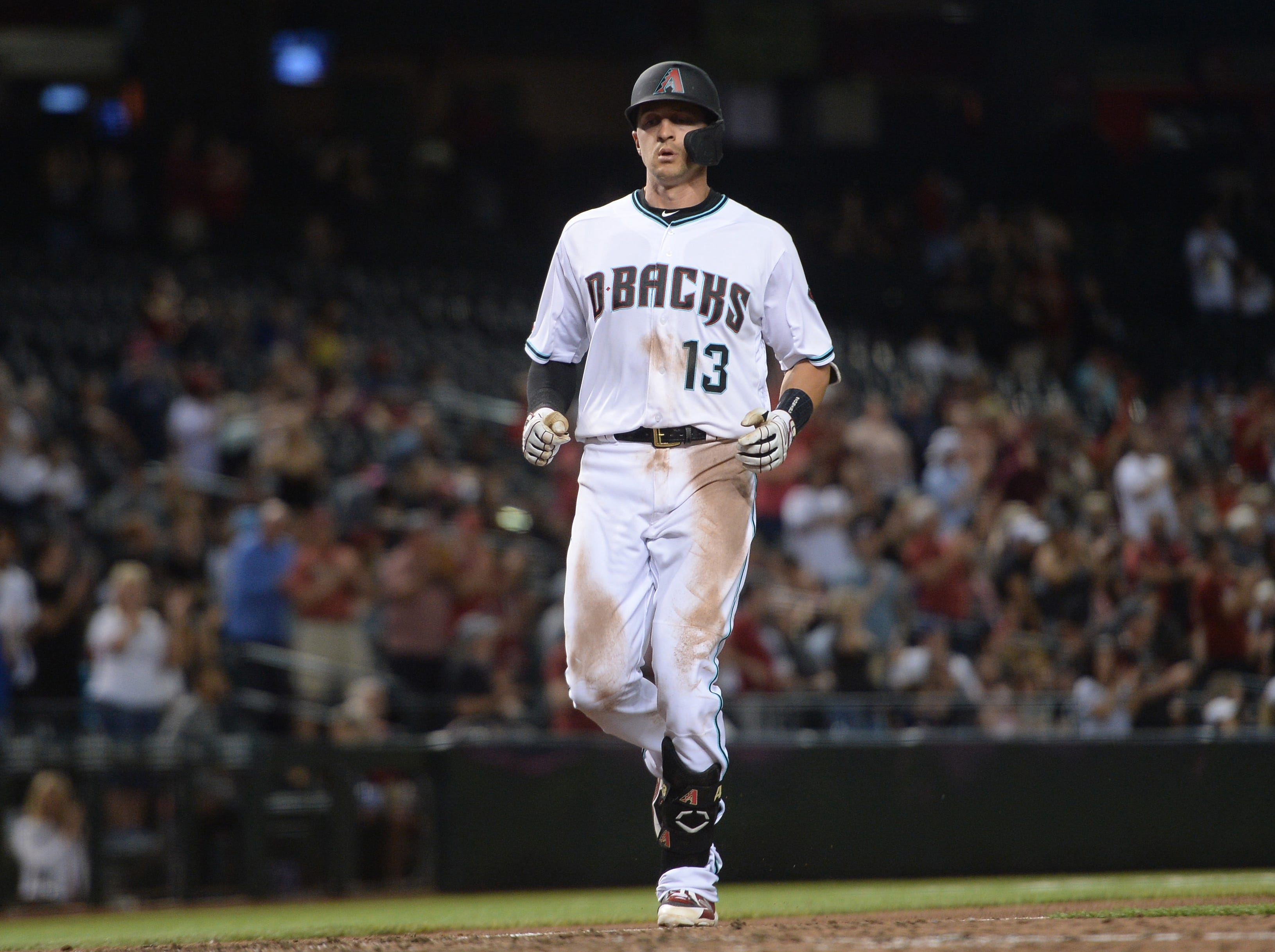 Apr 9, 2019; Phoenix, AZ, USA; Arizona Diamondbacks shortstop Nick Ahmed (13) approaches home plate after hitting a solo home run against the Texas Rangers during the seventh inning at Chase Field. Mandatory Credit: Joe Camporeale-USA TODAY Sports