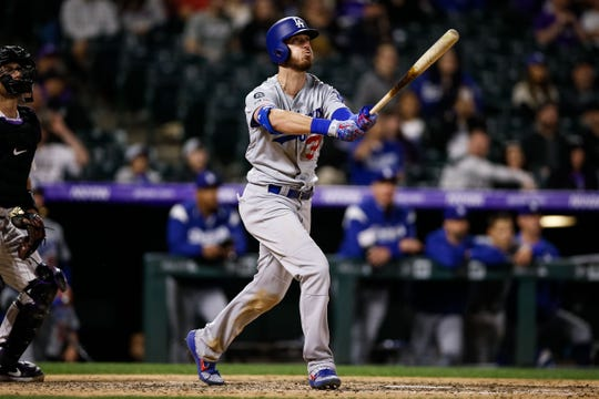 Los Angeles Dodgers right fielder Cody Bellinger (35) watches his solo home run in the eighth inning against the Colorado Rockies at Coors Field on April 7. Isaiah J. Downing-USA TODAY Sports