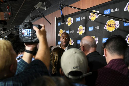 Lakers President of Basketball Operations Magic Johnson speaks to the media before a game against the Trail Blazers at Staples Center.